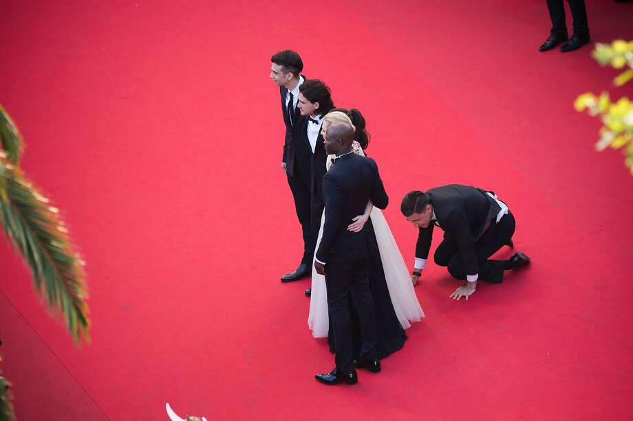 A man invades the Red Carpet as (L-R) Jay Baruchel, Kit Harington, America Ferrera, Cate Blanchett and Djimon Hounsou pose at the 'How To Train Your Dragon 2' premiere during the 67th Annual Cannes Film Festival on May 16, 2014 in Cannes, France. Photo: Francois Durand, Getty Images