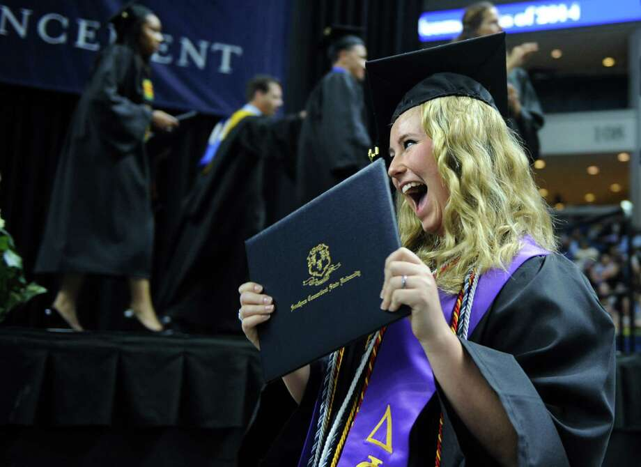 Lindsey Prusak, of Monroe, holds up her diploma during Southern Connecticut State University's commencement ceremony Friday, May 16, 2014, at the Webster Bank Arena in Bridgeport, Conn. Photo: Autumn Driscoll / Connecticut Post