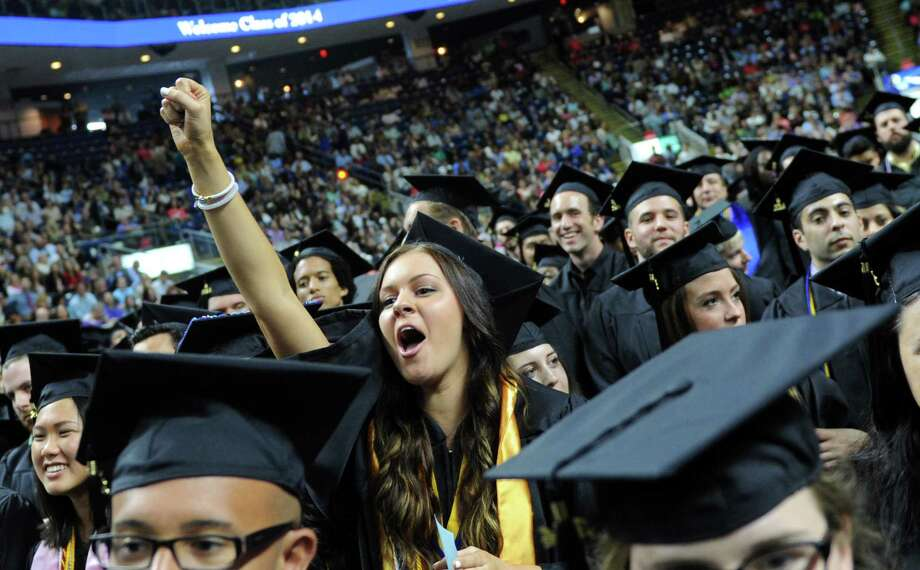 Catherine Gruszka, of Prospect, cheers during Southern Connecticut State University's commencement ceremony Friday, May 16, 2014, at the Webster Bank Arena in Bridgeport, Conn. Photo: Autumn Driscoll / Connecticut Post