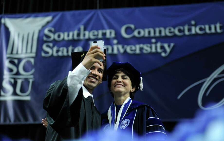 Oscar Castillo, of Norwalk, takes a picture with University President Dr. Mary Papazian during Southern Connecticut State University's commencement ceremony Friday, May 16, 2014, at the Webster Bank Arena in Bridgeport, Conn. Photo: Autumn Driscoll / Connecticut Post