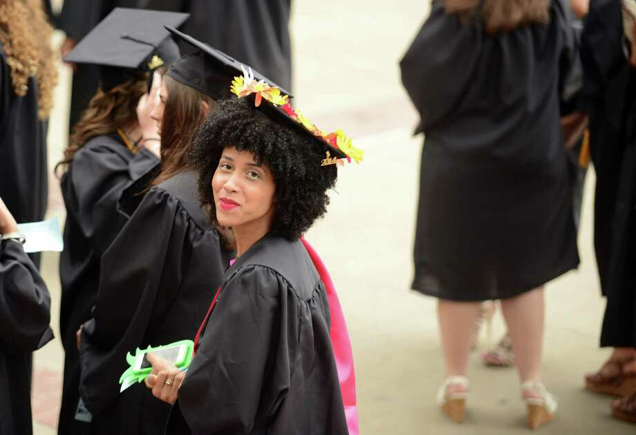 Tracey Williams, of Bridgeport, lines up with other graduates before Southern Connecticut State University's commencement ceremony Friday, May 16, 2014, at the Webster Bank Arena in Bridgeport, Conn. Photo: Autumn Driscoll / Connecticut Post