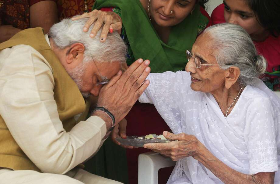 Man of the people: Ninety-year-old Hiraben blesses her son, Narendra Modi, India's prime minister-elect, at her home in 