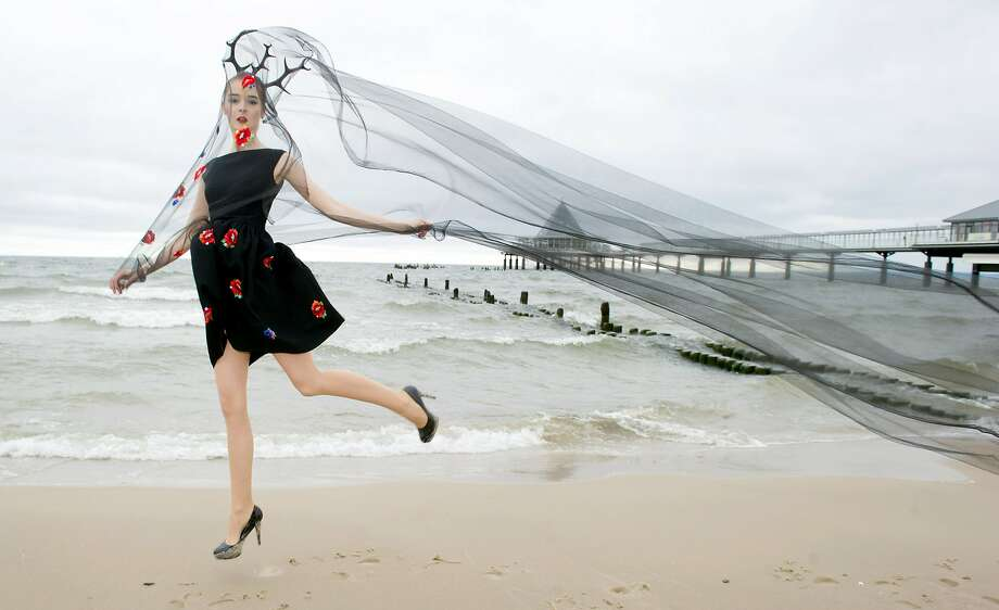 When wearing antlers at the beach, watch out for the fishing nets: A model named Elisa presents a creation by Estonia's Perat Puppart on the beach in Heringsdorf, Germany. Photo: Stefan Sauer, Associated Press