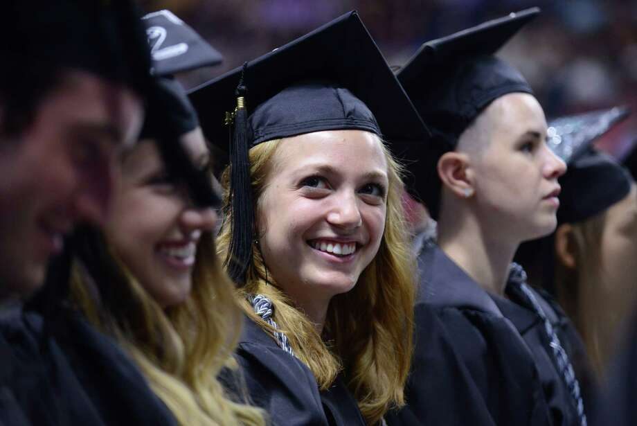 Southern Connecticut State University holds its undergraduate commencement ceremony Friday, May 16, 2014, at the Webster Bank Arena in Bridgeport, Conn. Photo: Autumn Driscoll / Connecticut Post