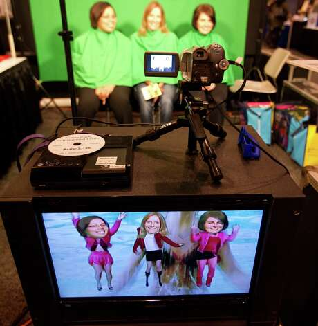Moira Cater, left, Valarie Brittain and Carrie Ibrahim create their own music DVD with Texas Party Entertainment.com. They were at the HR Houston gathering this week at the NRG Center. Photo: Billy Smith II, Staff