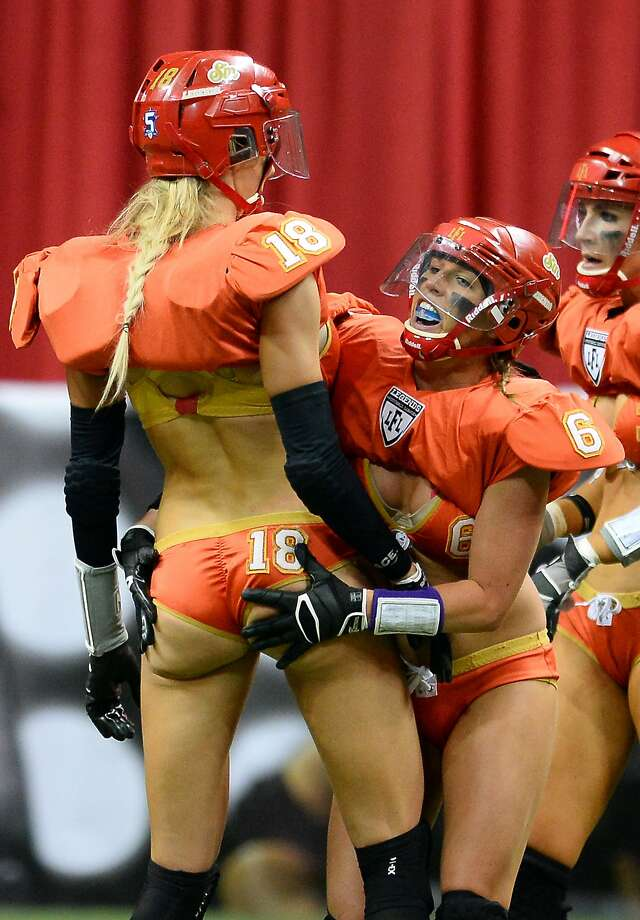 Does this qualify as 'excessive celebration'?Markie Henderson (No. 6) congratulates teammate Cynthia Schmidt 
