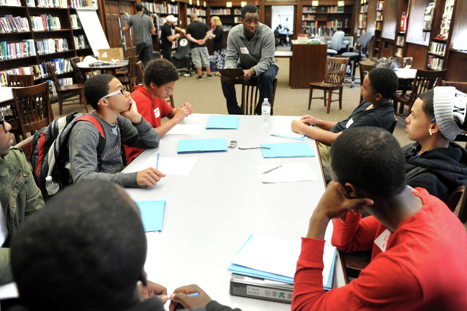 "Orlando Daniel speaks to Harding High School students at the the ""Becoming a Pro"" program, in Bridgeport, Conn. May 16, 2014. The program introduced male students at the school to the concepts of positive and professional self identity and charactor. Photo: Ned Gerard / Connecticut Post"