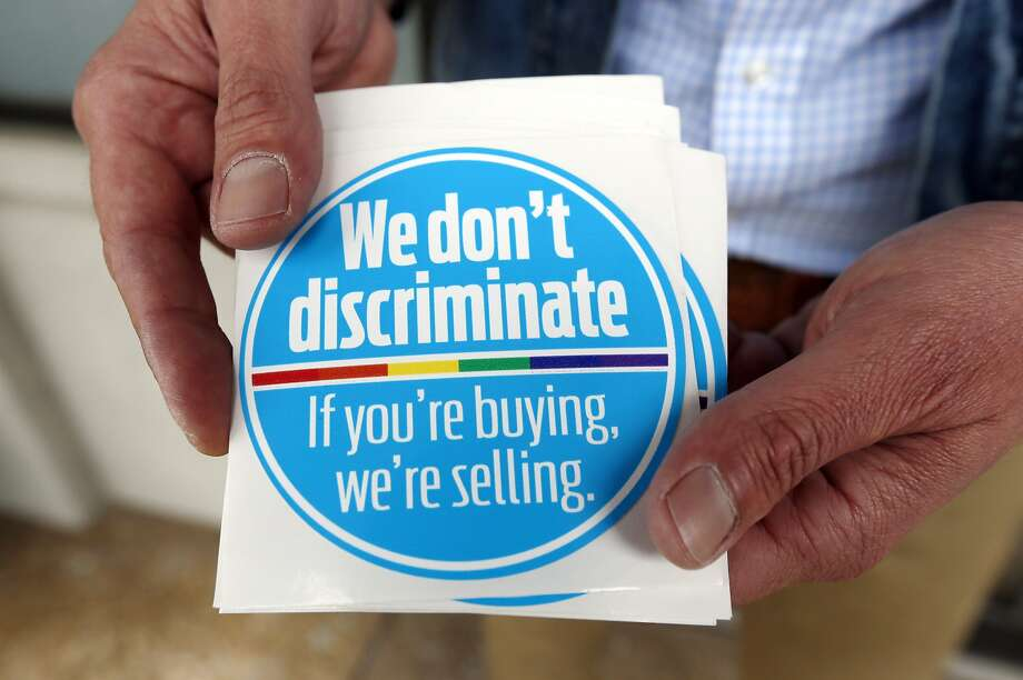 Mississippi businesses have started a campaign to ensure same-sex couples they're welcome. Photo: Rogelio V. Solis, Associated Press