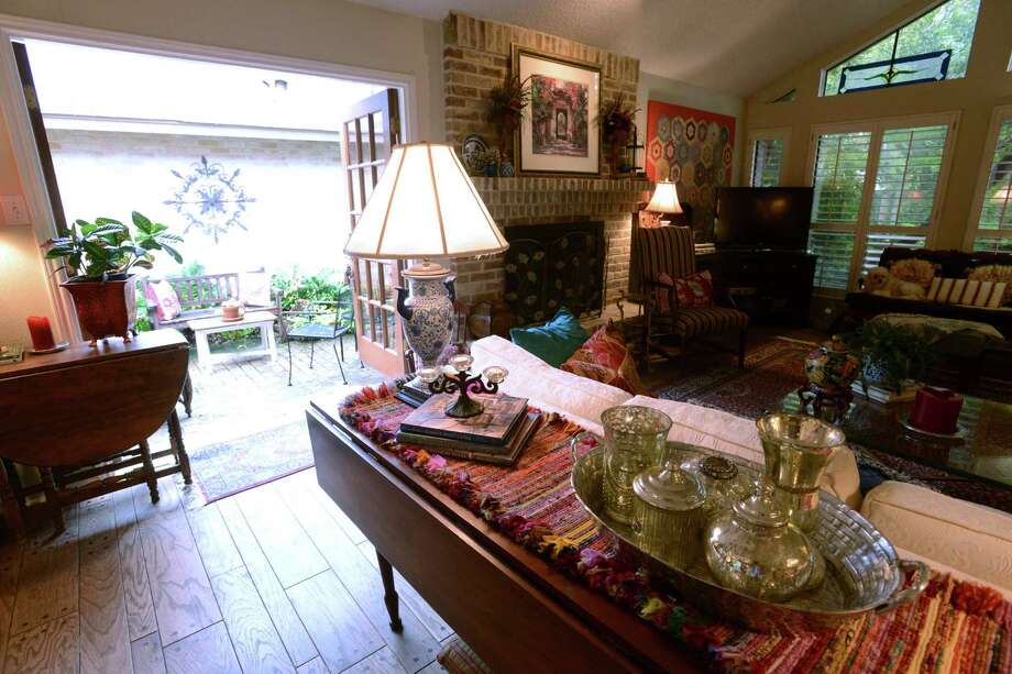 A maple harvest table is used as a buffet table in the home of Susan and Stan Marett. Photo: San Antonio Express-News / San Antonio Express-News