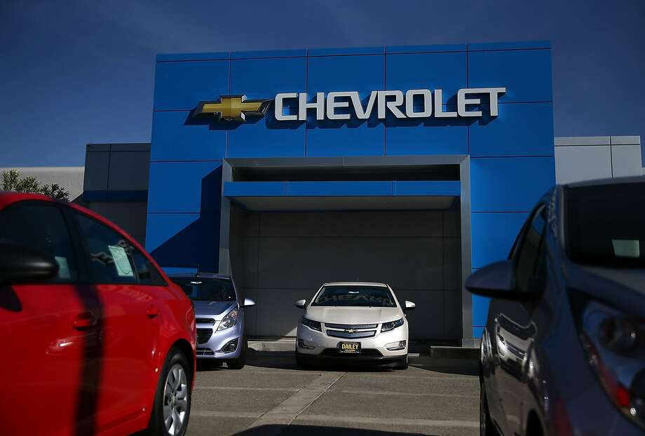 New cars sit on the lot at F.H. Dailey Chevrolet in San Leandro in May. Sales of GM cars fell slightly in August, but its truck and SUV sales were up 18 percent. Photo: Justin Sullivan, Getty Images