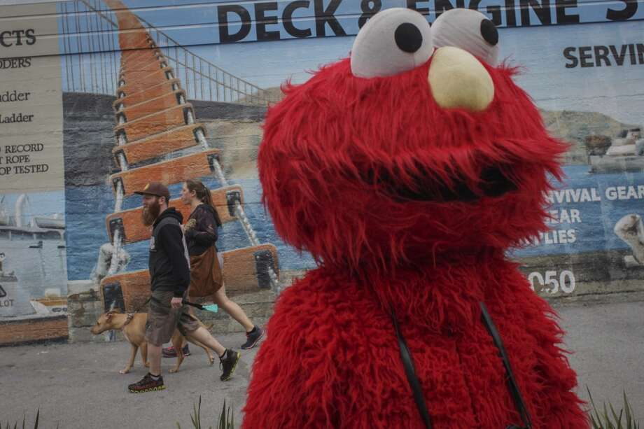 Dress as S.F.'s Evil Elmo. But please don't act like him.  Photo: Sam Wolson, Special To The Chronicle