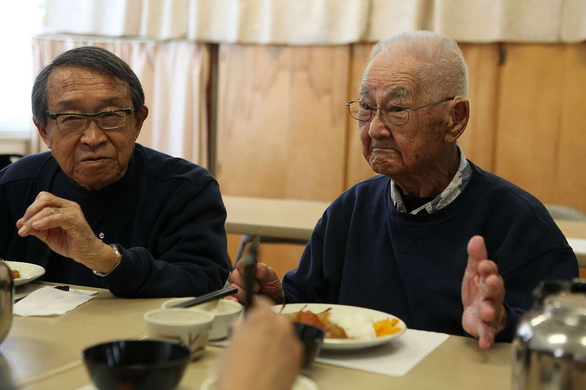 Author George Yoshida (left), 90 years old, and Bill Otani, 99 years old, having lunch at J-Sei in Berkeley, California, on Wednesday, May 30, 2012. George had written a book about swing bands that existed during the Japanese encampments and teaches tai chi and yoga on mondays, and Bill who will be 100 years old on July 1st this year. is a UC Cal graduate of chemistry. Berkeley is considering re-instating funding to J-Sei, a non-profit senior center for Japanese Americans.