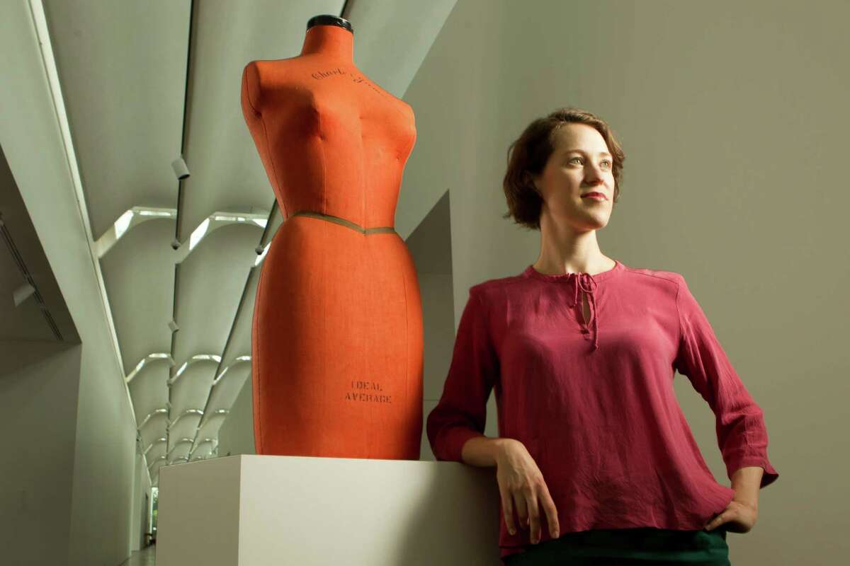 """Susan Sutton, curatorial assistant at the Menil Collection, poses for a portrait with a Charles James dress form on Monday, May 12, 2014, in Houston. Sutton has organized the exhibition """"A Thin Wall of Air: Charles James."""" Sutton is wearing a top by Humanoid, a skirt by Samuji and sandals by Rachel Comey. ( Brett Coomer / Houston Chronicle )"""