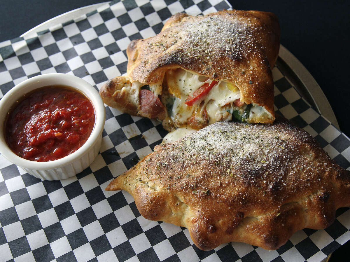 Tank's Pizza | Tank's is open for delivery and take-out during COVID-19. Their ooey, gooey calzones are perfect to share and remain a fan favorite.
