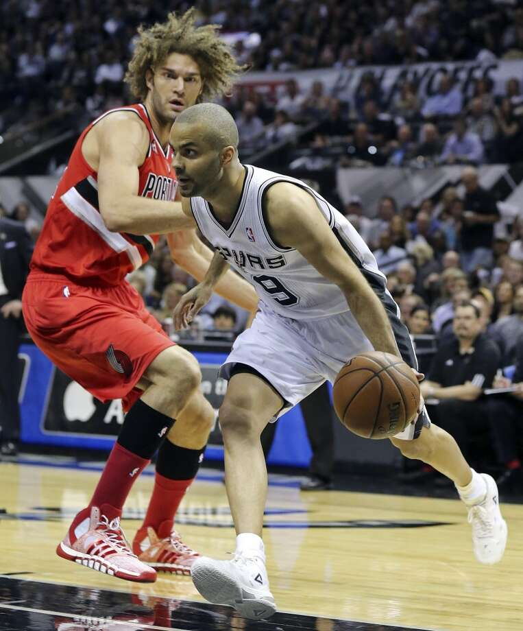 San Antonio Spurs' Tony Parker drives around Portland Trail Blazers' Robin Lopez during first half action of Game 5 in the Western Conference semifinals Wednesday May 14, 2014 at the AT&T Center. Photo: Edward A. Ornelas, San Antonio Express-News