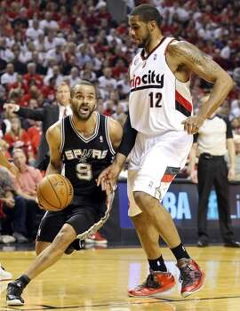 San Antonio Spurs' Tony Parker looks drives around Portland Trail Blazers' LaMarcus Aldridge during first half action of Game 4 in the Western Conference semifinals Monday May 12, 2014 at the Moda Center in Portland, OR. Photo: Edward A. Ornelas, San Antonio Express-News