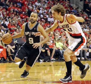 San Antonio Spurs' Tony Parker looks for room around Portland Trail Blazers' Robin Lopez during second half action of Game 3 in the Western Conference semifinals Saturday May 10, 2014 at the Moda Center in Portland, OR. Photo: Edward A. Ornelas, San Antonio Express-News