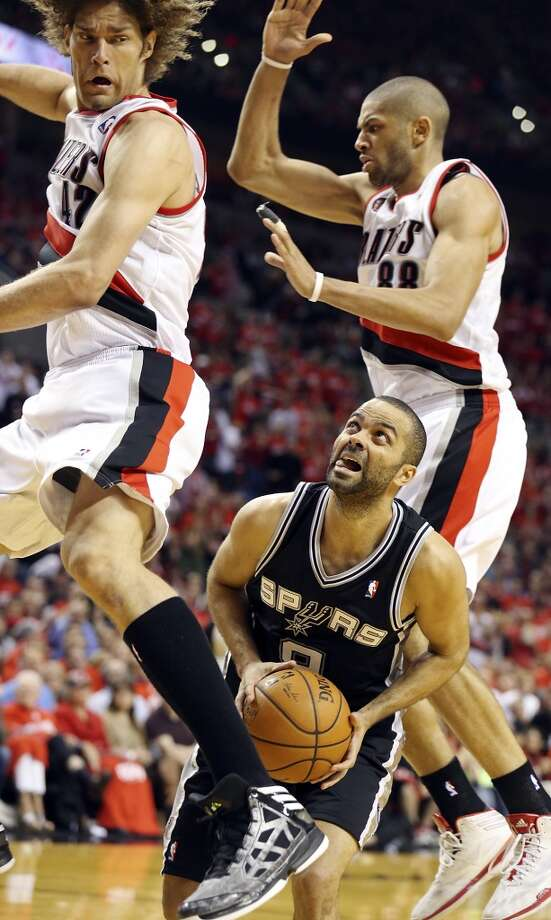 San Antonio Spurs' Tony Parker looks for room between Portland Trail Blazers' Robin Lopez (left) and Nicolas Batum during second half action of Game 3 in the Western Conference semifinals Saturday May 10, 2014 at the Moda Center in Portland, OR. Photo: Edward A. Ornelas, San Antonio Express-News