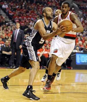 San Antonio Spurs' Tony Parker shoots around Portland Trail Blazers' LaMarcus Aldridge during first half action of Game 3 in the Western Conference semifinals Saturday May 10, 2014 at the Moda Center in Portland, OR. Photo: Edward A. Ornelas, San Antonio Express-News