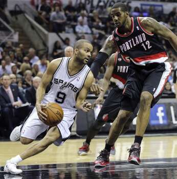 San Antonio Spurs' Tony Parker looks for room around Portland Trail Blazers' LaMarcus Aldridge during first half action of Game 2 in the Western Conference semifinals Thursday May 8, 2014 at the AT&T Center. Photo: Edward A. Ornelas, San Antonio Express-News