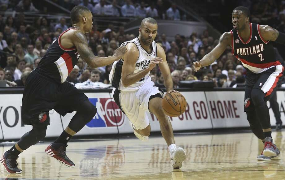 Tony Parker bursts into an opening to the bucket as the Spurs play the Portland Trailblazers in the first game of the Western Conference Semifinals at the AT&T Center on May 6, 2014. Photo: TOM REEL, San Antonio Express-News