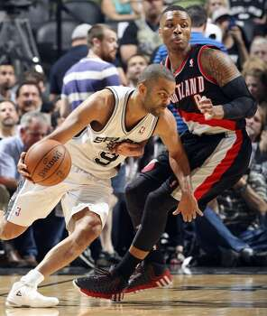 San Antonio Spurs' Tony Parker looks for room around Portland Trail Blazers' Damian Lillard during first half action of Game 1 in the Western Conference semifinals Tuesday May 6, 2014 at the AT&T Center. Photo: Edward A. Ornelas, San Antonio Express-News