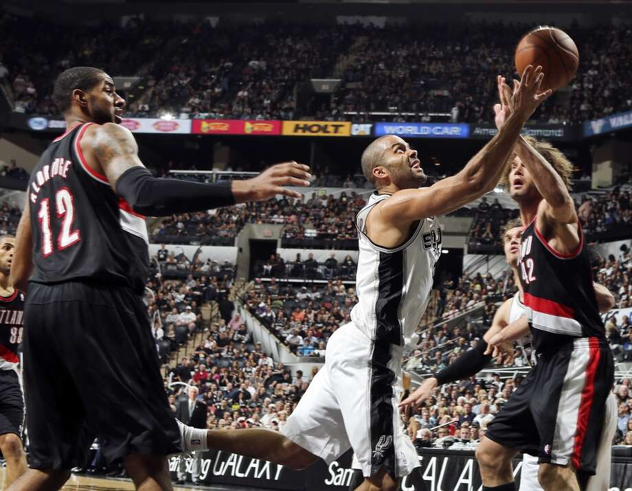San Antonio Spurs' Tony Parker shoots between Portland Trail Blazers' LaMarcus Aldridge (left) and Portland Trail Blazers' Robin Lopez during second half action of Game 1 in the Western Conference semifinals Tuesday May 6, 2014 at the AT&T Center. The Spurs won 116-92. Photo: Edward A. Ornelas, San Antonio Express-News