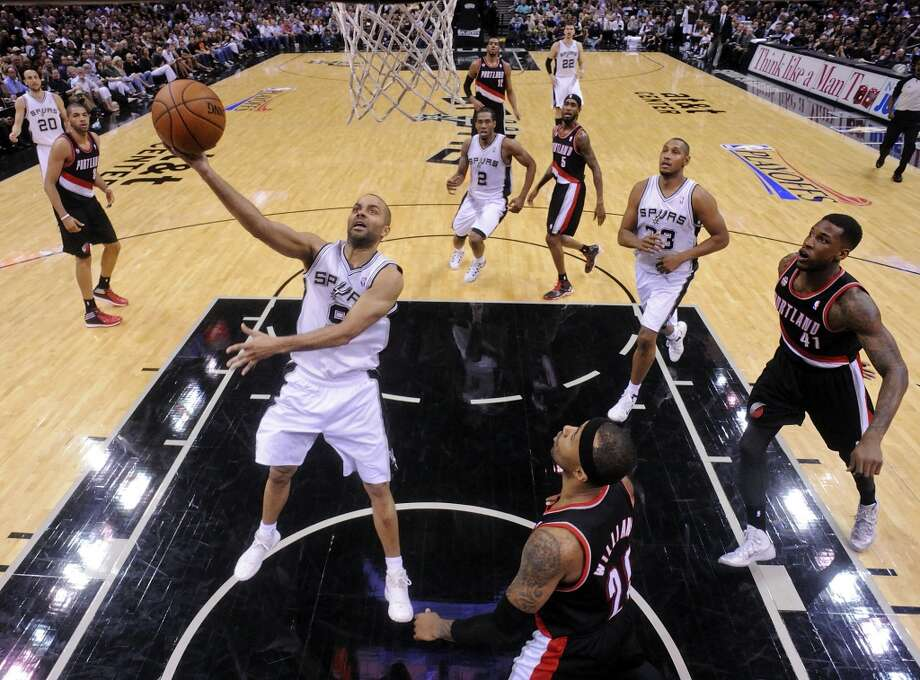 San Antonio Spurs' Tony Parker shoots around Portland Trail Blazers' Mo Williams during second half action of Game 1 in the Western Conference semifinals Tuesday May 6, 2014 at the AT&T Center. The Spurs won 116-92. Photo: Edward A. Ornelas, San Antonio Express-News