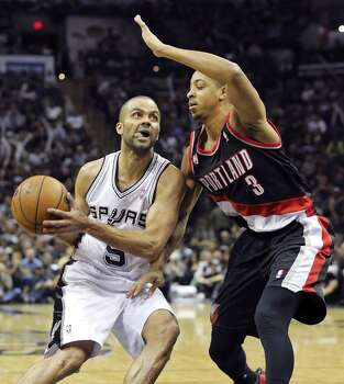San Antonio Spurs' Tony Parker looks for room around Portland Trail Blazers' C.J. McCollum during second half action of Game 1 in the Western Conference semifinals Tuesday May 6, 2014 at the AT&T Center. The Spurs won 116-92. Photo: Edward A. Ornelas, San Antonio Express-News