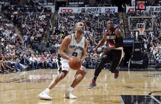 San Antonio Spurs' Tony Parker drives to the basket around Portland Trail Blazers' Wesley Matthews during second half action of Game 1 in the Western Conference semifinals Tuesday May 6, 2014 at the AT&T Center. The Spurs won 116-92. Photo: Edward A. Ornelas, San Antonio Express-News