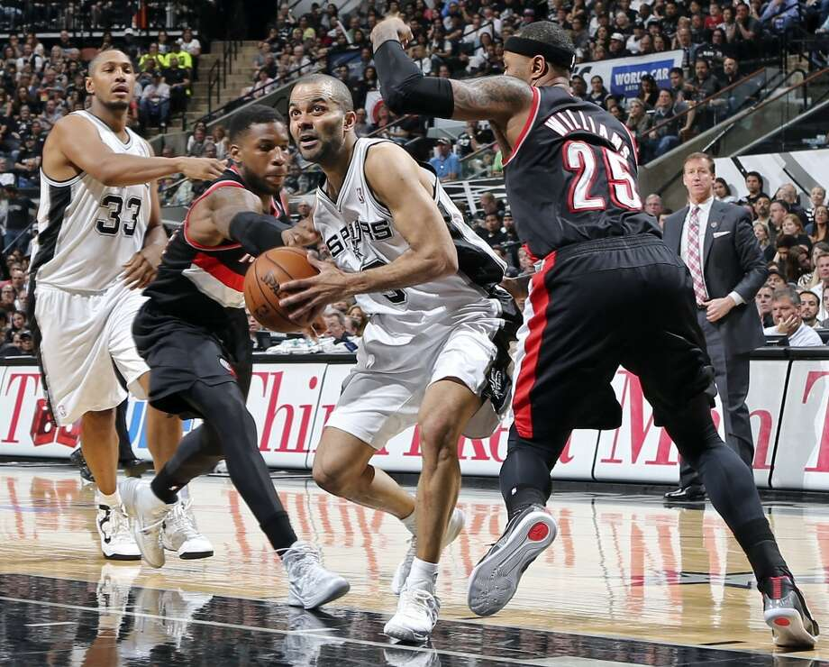 San Antonio Spurs' Tony Parker looks for room between Portland Trail Blazers' Thomas Robinson (left) and Mo Williams during second half action of Game 1 in the Western Conference semifinals Tuesday May 6, 2014 at the AT&T Center. The Spurs won 116-92. Photo: Edward A. Ornelas, San Antonio Express-News