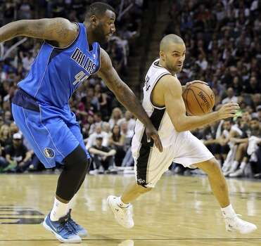 San Antonio Spurs' Tony Parker drives around Dallas Mavericks' DeJuan Blair during second half action of Game 7 in the first  round of the Western Conference playoffs  Sunday May 4, 2014 at the AT&T Center. The Spurs won 119-96. The Spurs advance to face Portland in the Western Conference semifinals. Photo: Edward A. Ornelas, San Antonio Express-News