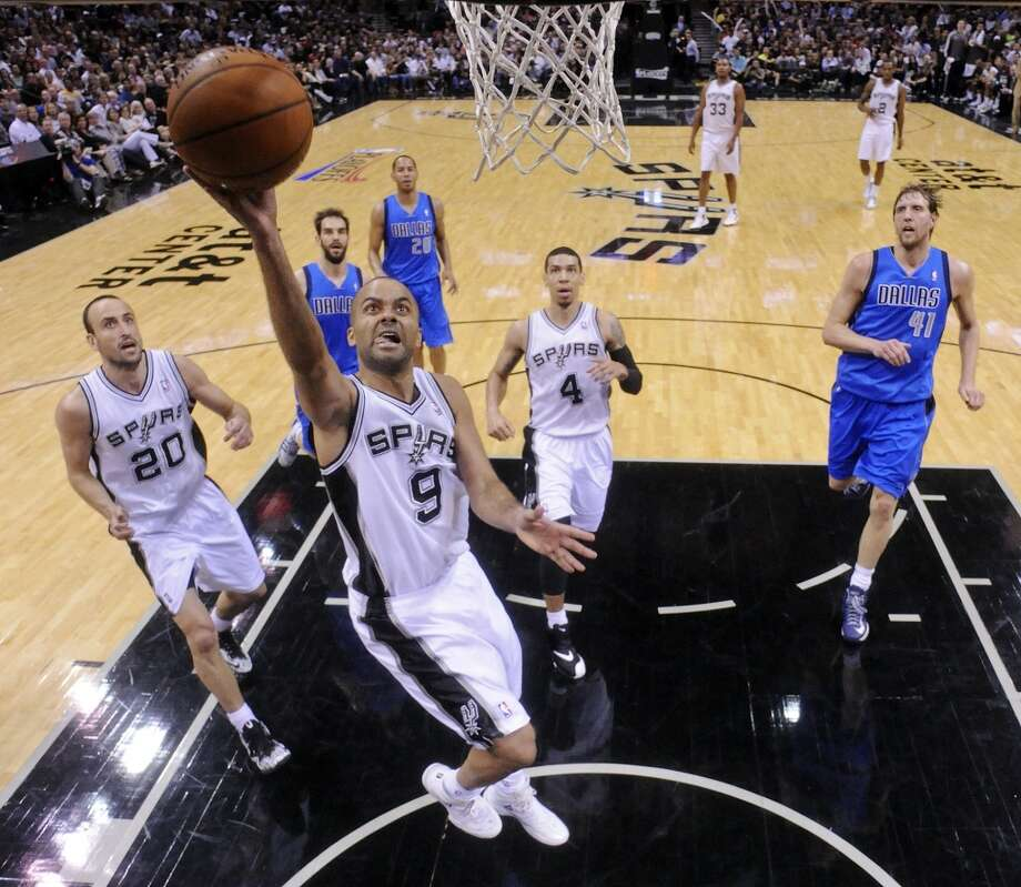 San Antonio Spurs' Tony Parker drives to the basket during second half action of Game 7 in the first  round of the Western Conference playoffs against the Dallas Mavericks Sunday May 4, 2014 at the AT&T Center. The Spurs won 119-96. The Spurs advance to face Portland in the Western Conference semifinals. Photo: Edward A. Ornelas, San Antonio Express-News