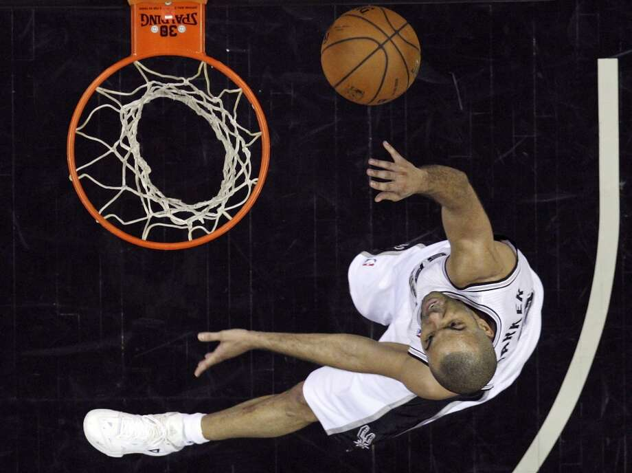 San Antonio Spurs' Tony Parker shoots during second half action of Game 7 in the first  round of the Western Conference playoffs against the Dallas Mavericks Sunday May 4, 2014 at the AT&T Center. The Spurs won 119-96. The Spurs advance to face Portland in the Western Conference semifinals. Photo: Edward A. Ornelas, San Antonio Express-News