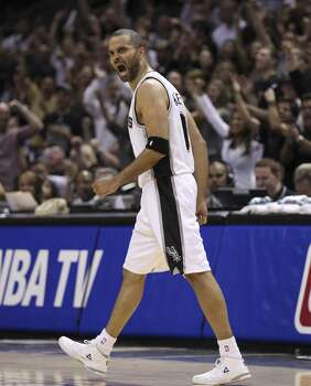 Spurs' Tony Parker (09) reacts after hitting a jump shot against the Dallas Mavericks in the second half of Game 5 of the first round of the Western Conference playoffs at the AT&T Center on Wednesday, Apr. 30, 2014. Spurs defeated the Mavericks, 109-103. (Kin Man Hui/San Antonio Express-News) Photo: Kin Man Hui, San Antonio Express-News