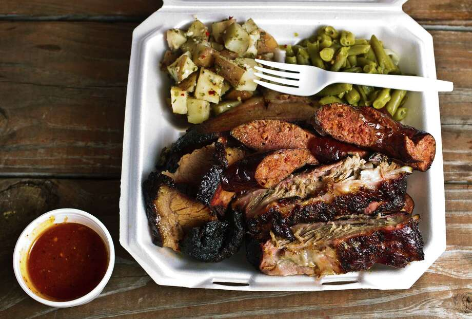 Brooks Place BBQ's three meat plate, sliced beef, pork ribs and sausage link. Photo: Nick De La Torre, Staff / © 2013  Houston Chronicle