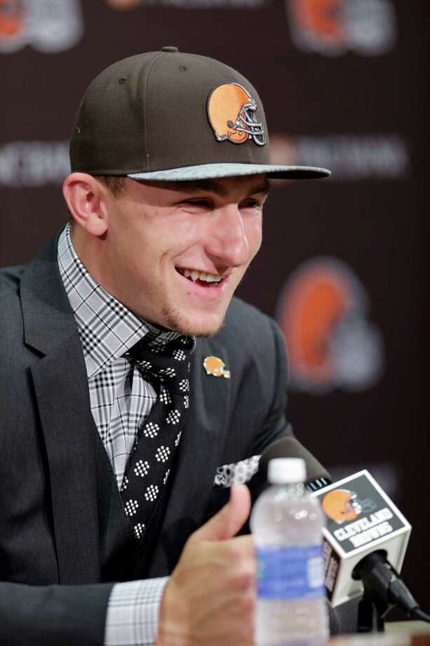 Cleveland Browns quarterback Johnny Manziel, from Texas A&M, answers questions at his introductory news conference at the NFL football team's facility in Berea, Ohio Friday, May 9, 2014. The Browns chose Manziel with the 22nd overall pick in the NFL draft (AP Photo/Tony Dejak) Photo: Tony Dejak, STF / AP