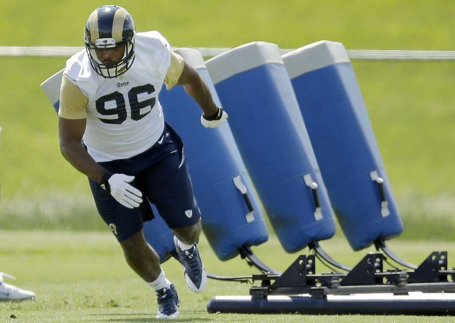 St. Louis defensive end Michael Sam takes part in a drill during Rams rookie camp. Photo: Jeff Roberson, Associated Press