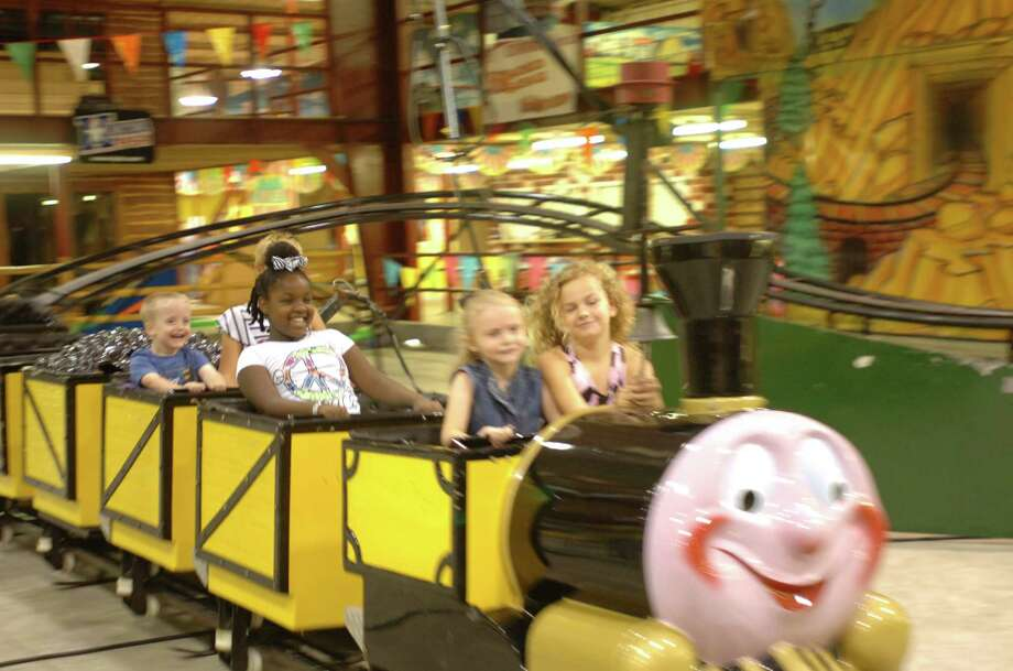 Carson Ivey, Ramsey Henderson, Savannah Ivey and Elise Griffin go for a test run on one of the rides at Elise's Play House, an indoor amusement center at Nuttty Jerry's that opens to the public next Saturday. Photo: Sarah Moore