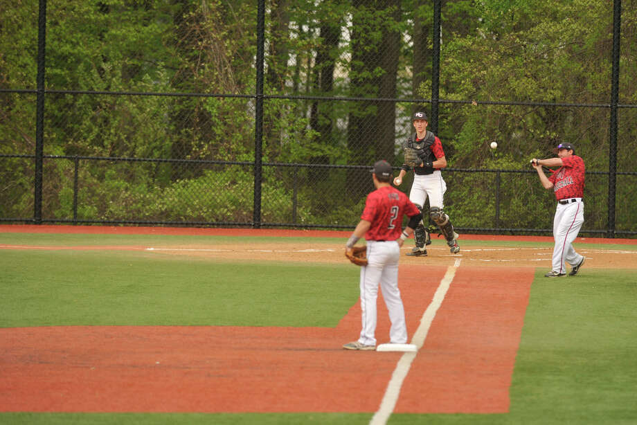 New Canaan takes infield practice before playing Darien on the artificial turf baseball field at Darien High School in Darien, Conn., photograped on Wednesday, May 14, 2014. Photo: Jason Rearick / Stamford Advocate