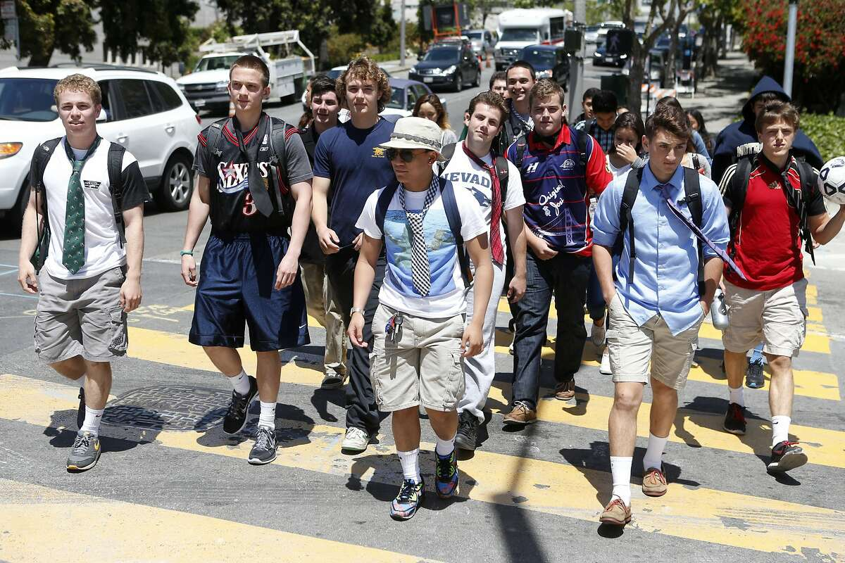Students of Sacred Heart Cathedral Preparatory wear ties in solidarity for Jessica Urbina, a female student who's graduation photo was removed from the yearbook because she was wearing a tuxedo, on Friday, May 16, 2014 in San Francisco, Calif.