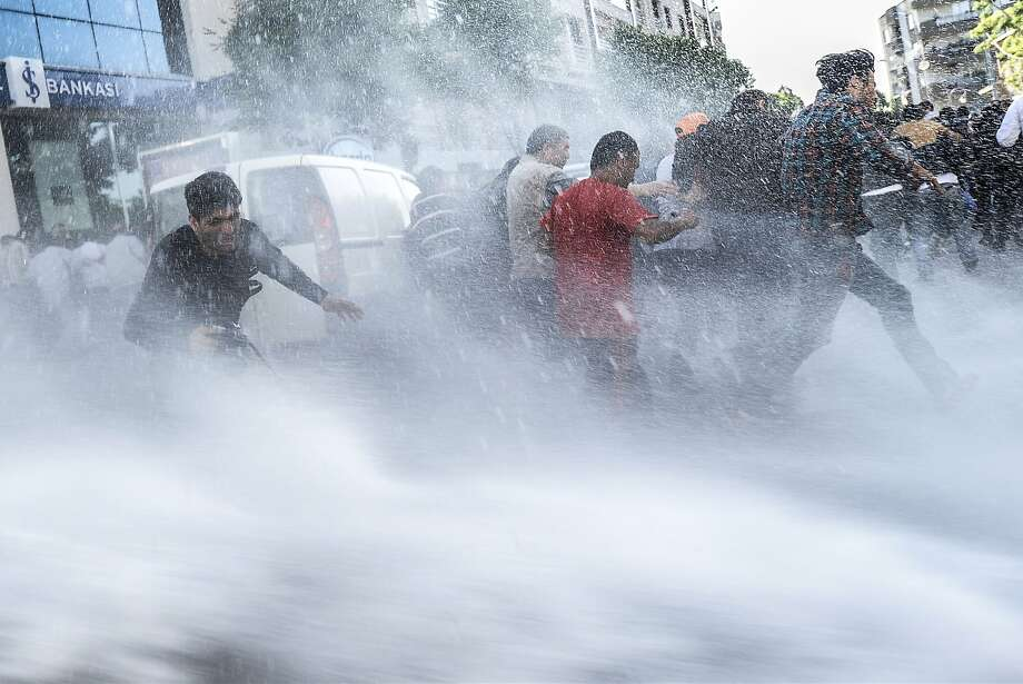 Backlash after mine tragedy:In Soma, Turkey, riot police blast protesters with water cannons during a 