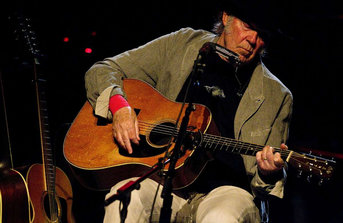 """Neil Young performs at the Dolby Theatre in Hollywood, Calif., on March 29, 2014. On his latest release, """"A Letter Home"""" he puts his unique views on songs by others. (Brian van der Brug/Los Angeles Times/MCT)"""