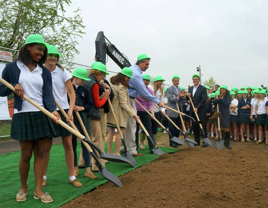 Convent of the Sacred Heart students and officials break ground at the site of the schoolís future athletic complex on its King Street campus. Photo: Paul Schott / Greenwich Time