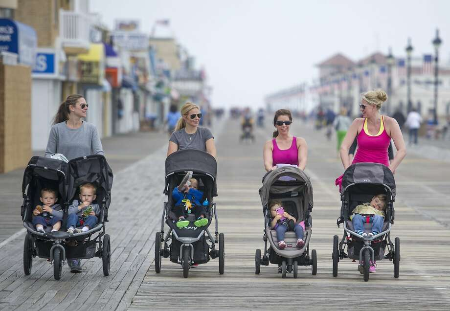 """On your mark, get set ...Jaclyn Todd (left), Korrin Dougherty, Marja Andrews, Shannon McAllister and their   children hit the boardwalk on their """"mom's play day"""" in Ocean City, N.J. Photo: Clem Murray, Associated Press"""