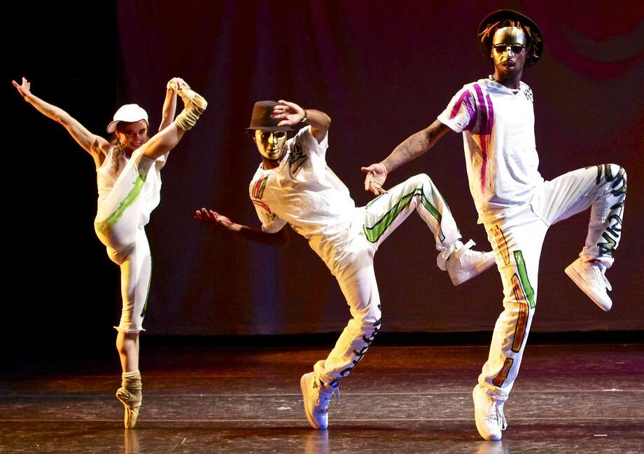 """Oakland Ballet dancer Sharon Wehner (left) with Turf Feinz's Rayshawn """"Looney"""" Thompson and Garion """"Noh-Justice"""" Morgan in """"Turfland."""" Photo: Christopher Dunn, Oakland Ballet"""