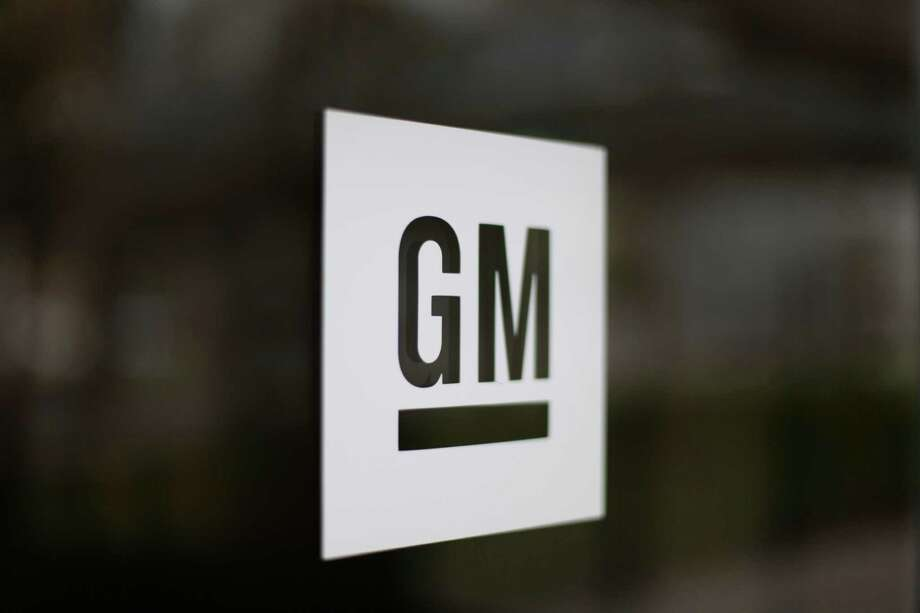 This Friday, May 16 2014 photo shows the General Motors logo at the company's world headquarters in Detroit. U.S. safety regulators fined General Motors a record $35 million Friday for taking at least a decade to disclose defects with ignition switches in small cars that are now linked to at least 13 deaths. (AP Photo/Paul Sancya)   ORG XMIT: MIPS102 Photo: Paul Sancya / AP