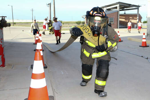 Cadet Juan Avila drags a fire hose during a Fitness Awareness Drill at the SAFD Fire Training Academy, 300 S. Callaghan, on Thursday, May 1, 2014.   MARVIN PFEIFFER/ mpfeiffer@express-news.net Photo: MARVIN PFEIFFER, Marvin Pfeiffer/ EN Communities / Express-News 2014