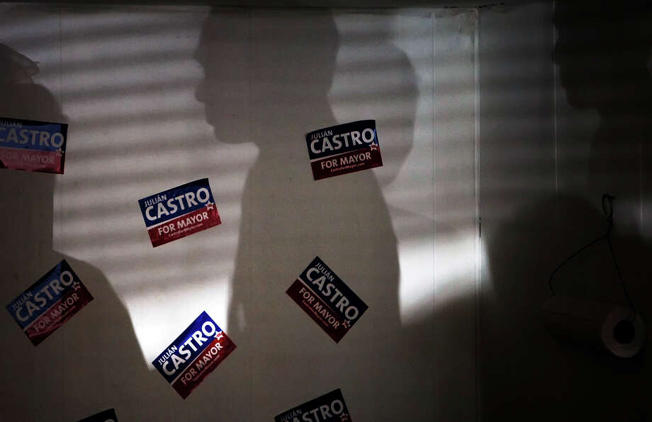 The shadow of mayoral candidate Julián Castro is cast on a wall of his campaign headquarters on March 21, 2009. Photo: KIN MAN HUI, San Antonio Express-News / kmhui@express-news.net