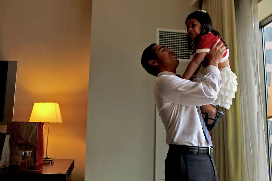 Mayor Julián Castro takes a break with his daughter, Carina, 3, in their hotel room as he prepares for his keynote speech during the Democratic National Convention in Charlotte, N.C., on Sept. 4, 2012. Photo: Lisa Krantz, San Antonio Express-News / San Antonio Express-News